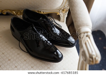 Grooms Wedding Shoes On Top Of White Chair Mans Black Lace Up Leather