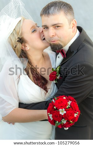 Groom surprised by the bride - stock photo