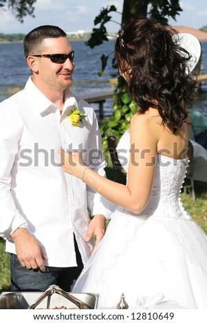 groom talking to bride - stock photo