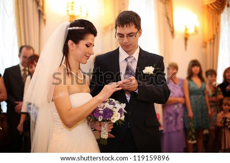 groom wears a wedding ring on the bride's wedding in Russia - stock photo