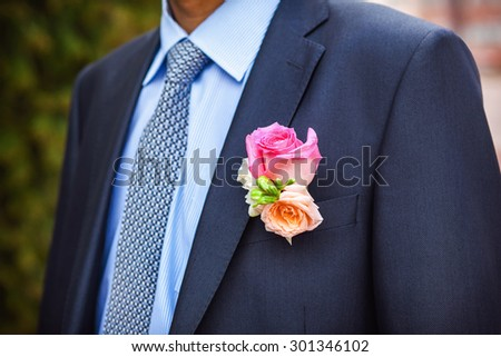 Groom with the boutonniere and tie