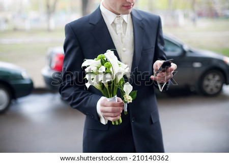 Groom with wedding bouquet.