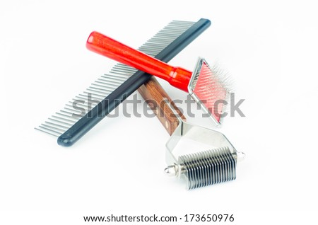 Grooming and trimming equipment for dogs isolated on white background - stock photo