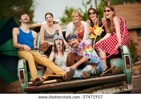 Groovy Group in the Back of Truck Laughing - stock photo