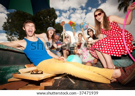 Groovy Group in the Back of Truck Making Noise - stock photo