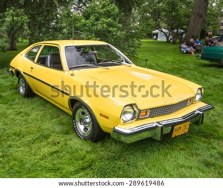 GROSSE POINTE SHORES, MI/USA - JUNE 21, 2015: A 1976 Ford Pinto Runabout car at the EyesOn Design car show, held at the Edsel and Eleanor Ford House. - stock photo