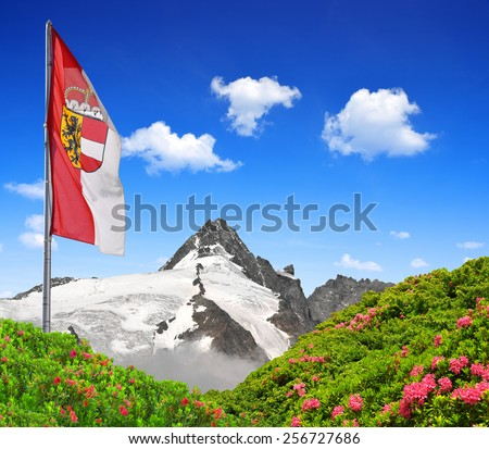 Grossglockner with flag of Salzburg , National Park Hohe Tauern, Austria - stock photo