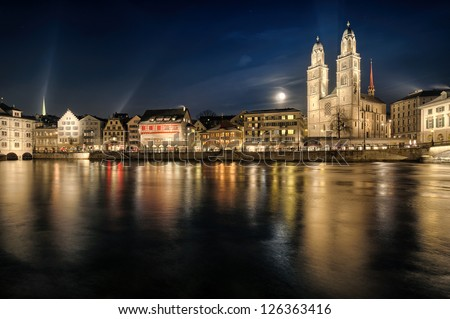 Grossmuenster church and Zurich city center by night. Switzerland. - stock photo