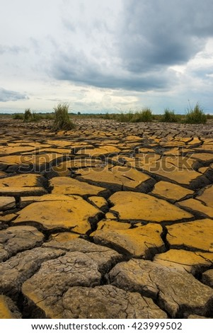 Ground broken by the drought ship aground in hard dramatic tone style. Bofore rainy day - stock photo