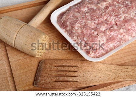 Ground chicken in polystyrene food tray - stock photo