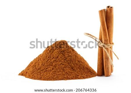 Ground cinnamon powder and sticks on white isolated background - stock photo