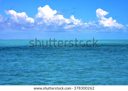 ground in mexico froath and blue  foam  the sea drop sunny day  wave - stock photo