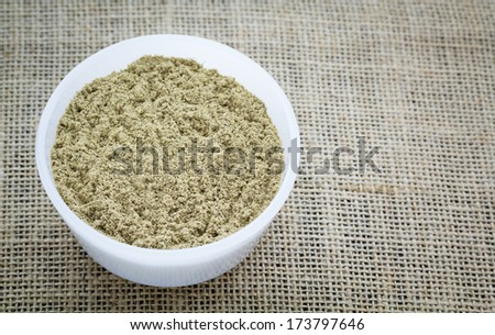 Ground Kava Kava Root in a White Bowl. - stock photo
