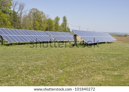ground mounted solar panels, an alternate source of electricity which uses the sun to generate power - stock photo
