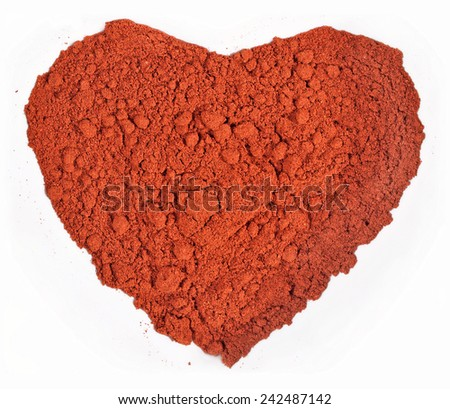 Ground paprika in the form of heart on a white background - stock photo