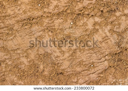 Ground texture background, with small rocks and dust. Excavation dirt texture exposed.  - stock photo