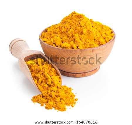 ground turmeric isolated on white background - stock photo