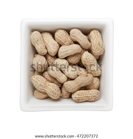 Groundnuts in a square bowl isolated on white background