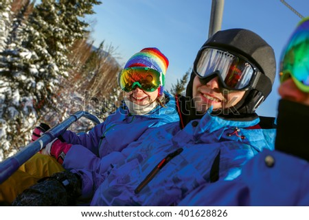 Group cheerful snowboarders on the mountain resort