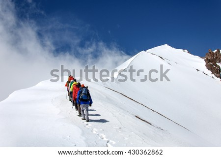 Group climbers goes down from the top of Erciyes volcano.