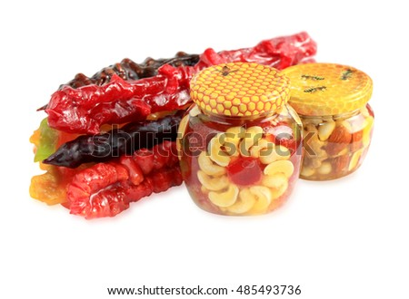 Group coloured churchkhela with nuts and candied fruits in honey isolated on a white background