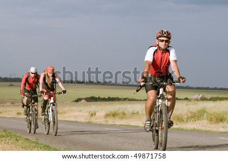 group cyclists relax biking