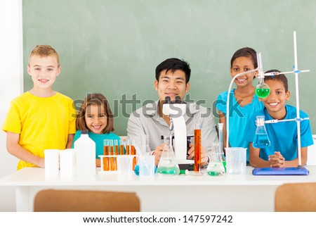 group elementary school students and teacher in a science class  - stock photo