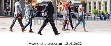 Group employees going against the office. Panorama. A group of businessmen. - stock photo