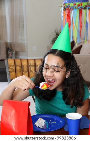 Group enjoying a birthday party for child - stock photo