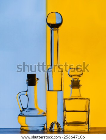 group glass bottles on color background - stock photo