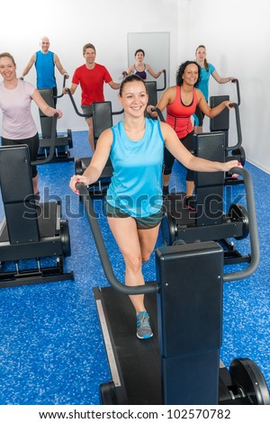 Group gym class walk treadmill running belt at fitness club - stock photo