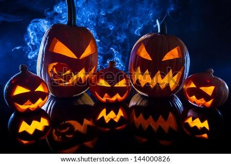 Group halloween pumpkins on the background smoke - stock photo