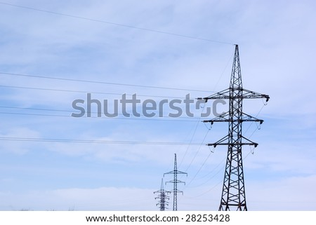 Group high voltage electricity pylons in the background of the sky