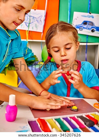 Group kids boy and girl mold from plasticine  in kindergarten . - stock photo