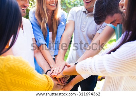 Group of a students hands together