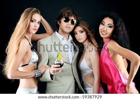 Group of a stylish young people. Fashion, beauty, entertainment. - stock photo