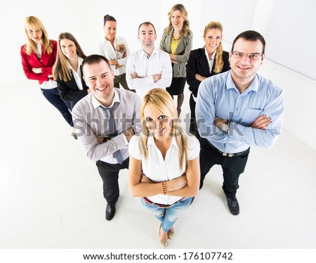 Group of a Successful Business People standing together with arm crossed and looking at the camera. - stock photo