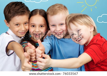 Group of adorable boys and girl showing thumbs up altogether - stock photo