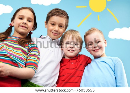 Group of adorable kids looking at camera in creative environment - stock photo