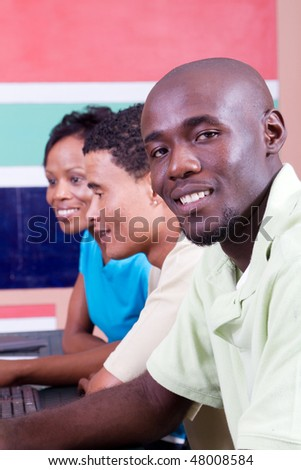 group of adult african american students learning computer