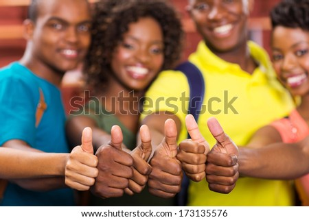 group of african american friends thumbs up closeup - stock photo