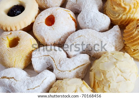 Group of almond biscuits sprinkled with sugar - stock photo