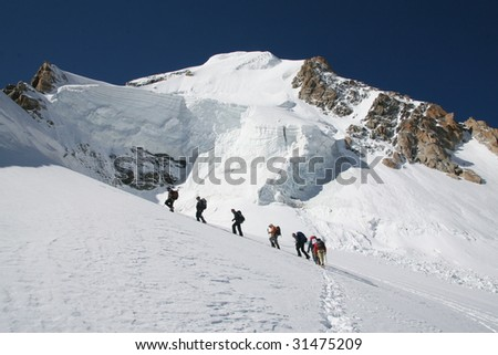 Group of alpinists in Alps.