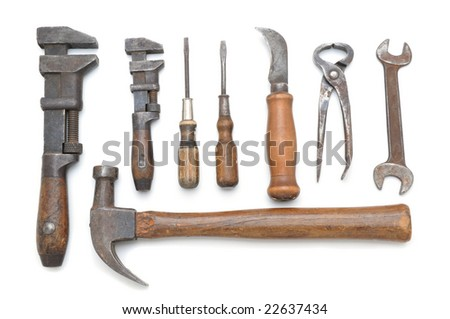 Group of antique hand tools on white background with slight shadows