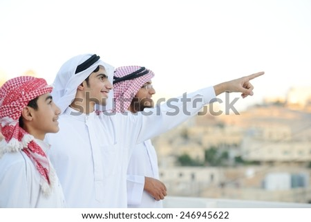 Group of Arabic boys standing in line and pointing