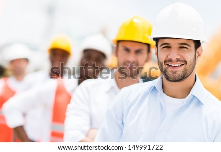 Group of architects and engineers at a building site  - stock photo