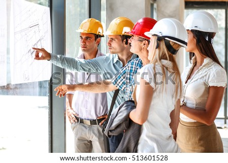 Group architects experts discuss about construction stock photo group of architects and experts discuss about construction projectlooking blueprint of new project malvernweather Gallery