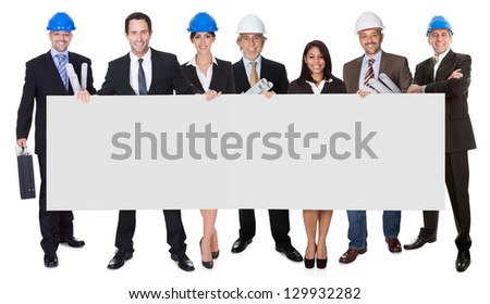 Group of architects people presenting empty banner. Isolated on white