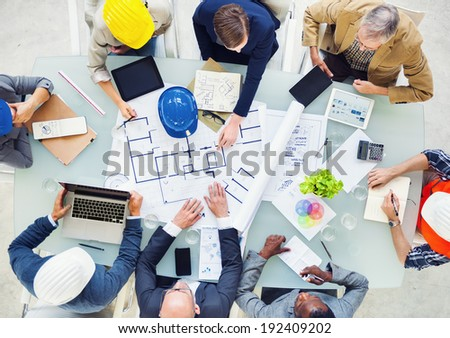 Group of Architects Planning on a New Project - stock photo