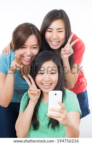 Group of Asian people enjoy their phone and selfie